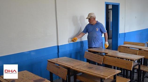 Veliler el ele verdi, okulu tamir edip boyadı